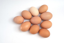 A Dozen Chicken Eggs On A White Background. View From Above