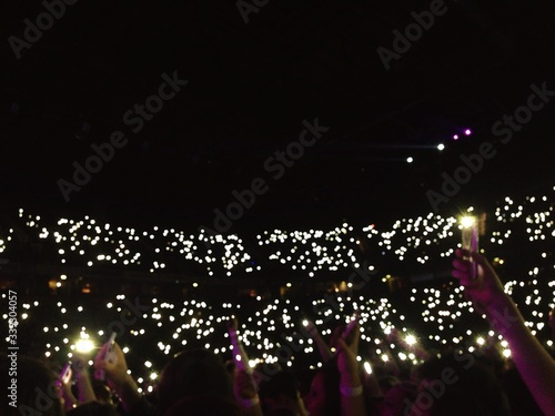 Foto Crowd Holding Illuminated Light At Music Concert At Night