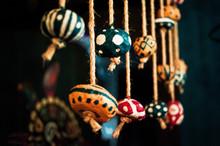 Large Colorful Beads Tied Behi...