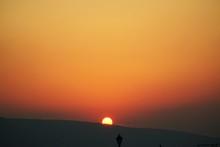 Silhouette Landscape Against Orange Sky