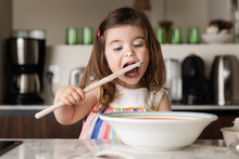 Cute Toddler Girl Tasting Food...