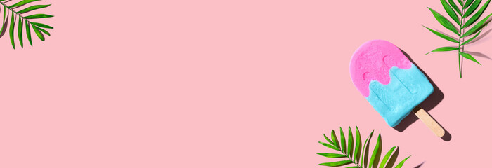 Popsicle with tropical plants - overhead view flat lay