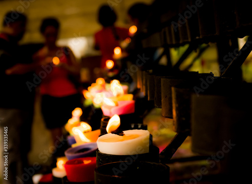 Fototapety, obrazy: Illuminated Candles In Temple