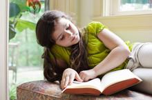 Girl Engrossed In Story, Readi...