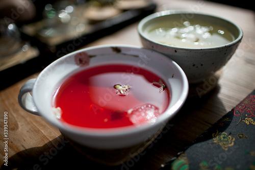 Obraz na plátně Close-up Of Plum Tea In Cup On Table