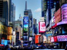 Illuminated Advertisements On Modern Buildings In City
