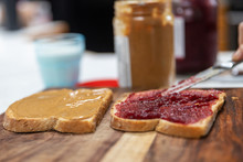 Peanut Butter And Jelly Sandwich Being Prepared In The Kitchen