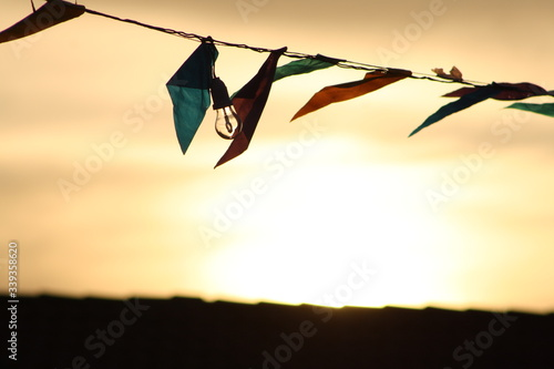 Bunting And Light Bulb Hanging On String During Sunset Wallpaper Mural