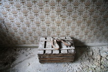 High Angle View Of Messy Sandals On Wooden Crate In Abandoned Room