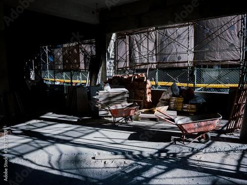 Wheelbarrows In Under Construction Building Fotobehang