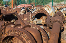 Rusty Metallic Valves And Industrial Pipelines In An Old Geothermal Power Plant, As Part Of The Industrial Waste Concept