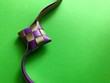 Leinwanddruck Bild - ribbon Ketupat decoration on green background