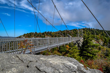 Mile High Swinging Bridge With Trees Against Cloudy Sky