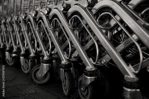 Obraz Close-up Of Shopping Cart On Field - fototapety do salonu