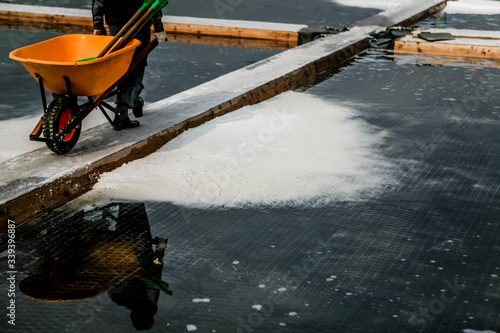 Canvas Low Section Of Person With Wheelbarrow On Salt Pan