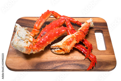 Cooked Organic Alaskan King Crab Legs with Butter and lemons, Alaskan King Crab on wood plate in white background Wallpaper Mural