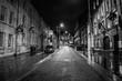 Empty Street Amidst Illuminated Buildings Against Sky At Night