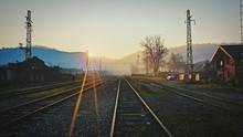 Railroad Tracks During Sunset