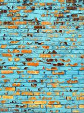 Full Frame Shot Of Blue Paint Peeling From Brick Wall