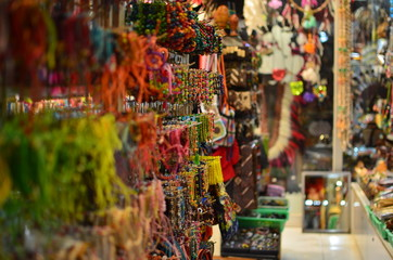 Various Colorful Bracelets Hanging At Market Stall