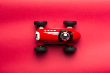 Number Five Painted On A Plate On A Red Toy Vintage Racing Car On A Red Board Background