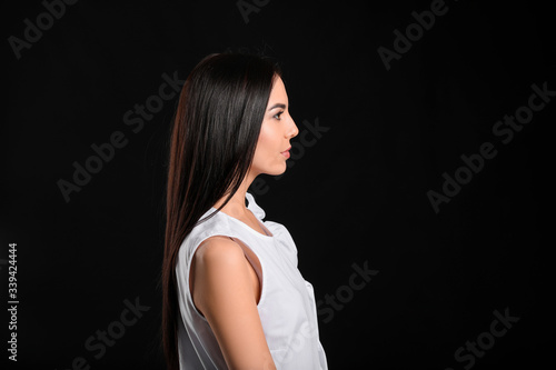 Young woman with beautiful healthy hair on dark background Tablou Canvas