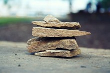 Close-up Of Stacked Rocks On Footpath
