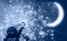 Ramadan Concept - Ramadan Kareem Cannon With Crescent And Fireworks - Night Sky With Moon In The Clouds At Sunset
