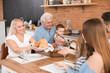 Big family having dinner together in kitchen