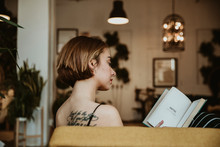 Girl Reading On The Couch