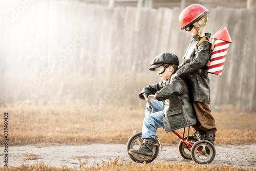 Obraz Children play in the rider and the rocketman - fototapety do salonu