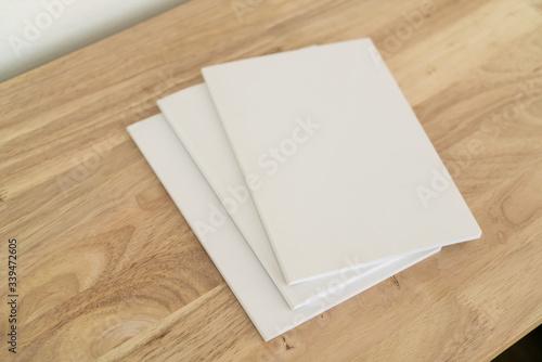 Obraz Blank catalog, magazines, book on wood background. - fototapety do salonu