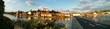 Panoramic Shot Of Bridge Over River In City Against Sky