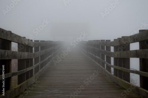 Canvas Print Wooden Footbridge Against Sky During Foggy Weather
