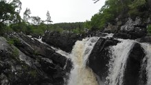 An Aerial Action Shot Panning Down Into The Plunge Pool Of Rogie Fall's Near Inverness. Captured Near Inverness Scotland During The NC500 (North Coast 500)