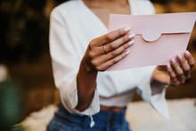 Holding An Envelope