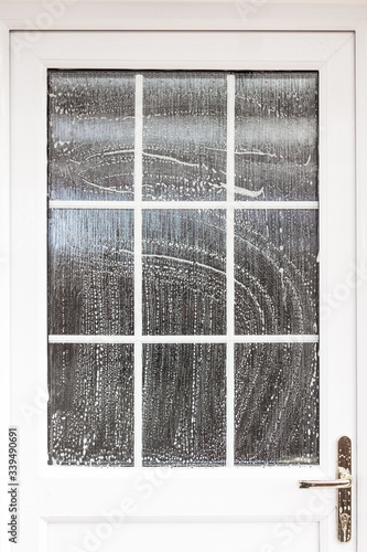 Cleaning door exterior - soapy suds cover a front door and window Tablou Canvas