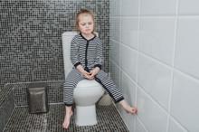 A Sad Little Girl Is Sitting O...