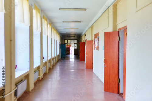 An empty school corridor stretching into the future Wallpaper Mural