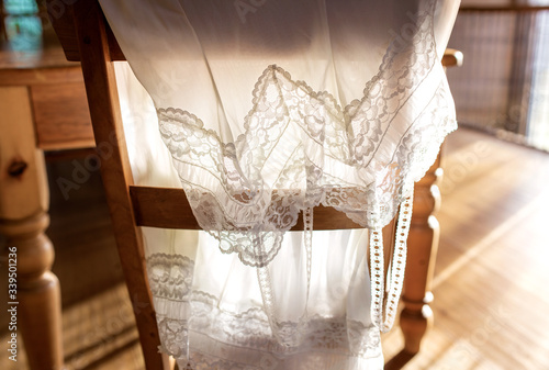 Obraz na plátně retro vintage backlit slip petticoat draped over chair