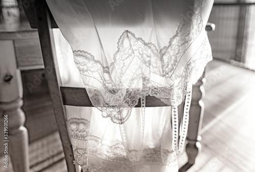Fotografie, Obraz retro vintage backlit slip petticoat draped over chair