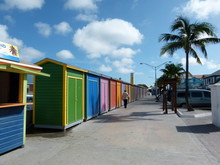 Multi Colored Huts On Street Against Sky