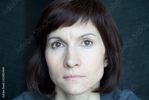 Portrait of mature woman in distress, close-up Wallpaper Mural