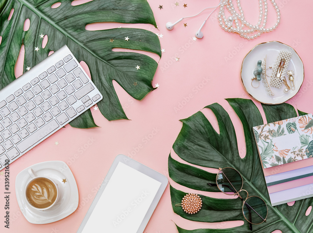 Fototapeta Modern flat lay  feminine workspace with stationery, Accessory on the pink table. Tropical View top. Still life scene