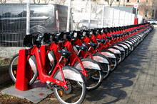 A Row Of Standing Bikes In Bri...