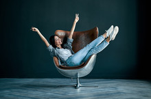 Asian Woman Sitting In Chair
