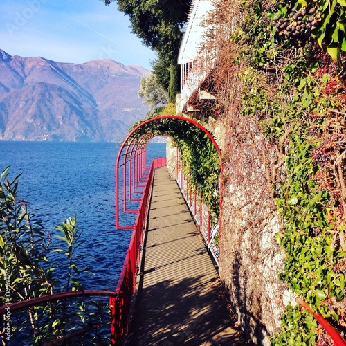 Fototapeta Lake Como And Mountain Seen From Walkway Of Varenna