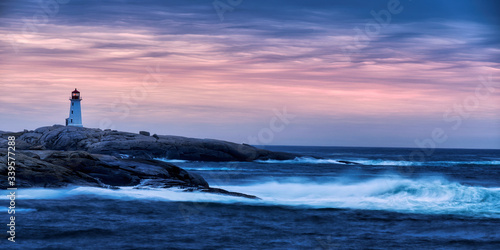 Obraz lighthouse on the coast at sunrise - fototapety do salonu