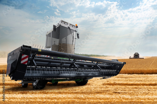 Aufkleber - Combine harvester on the wheat field.
