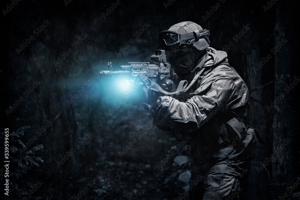 Fototapeta Portrait of a commando in the forest. The concept of military operations, international conflicts, special forces.